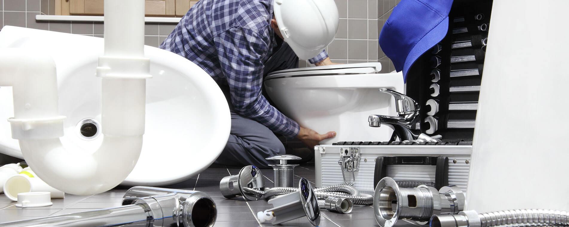 springfield Plumber fixing sink