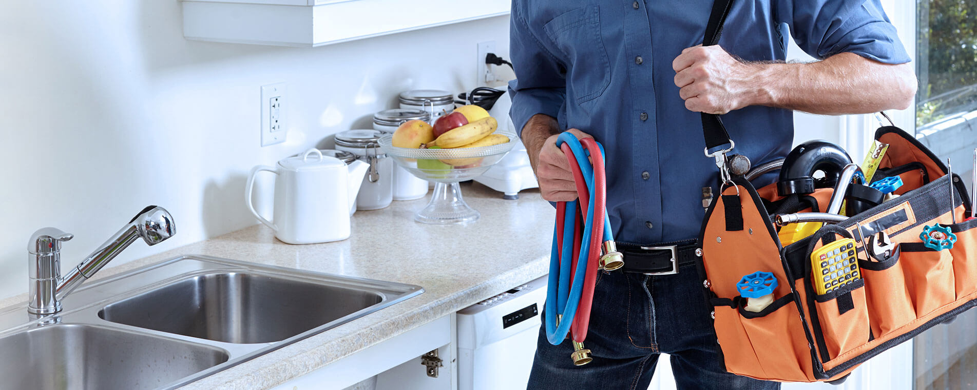 woodend Plumber fixing sink